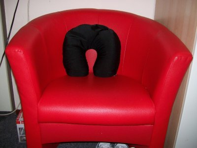 The notorious red chair and friendly pillow