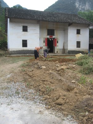 couple working in village