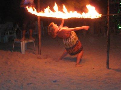 Pat Limboing under Fire on Ko Phi Phi Beach