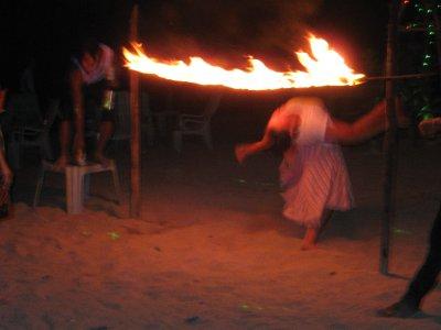 Sarah Limboing under Fire on Ko Phi Phi Beach