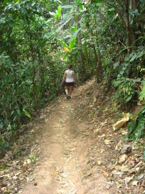 Sarah walking down the path to Ahka Hill Waterfall