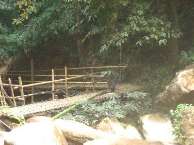 Ahka Hill Tribe Man Fixing Bridge