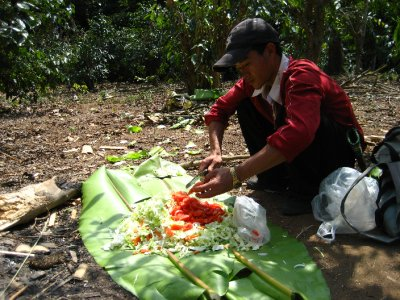 Cutting up the tomatoes on a banana leaf