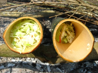 Vegetables cooking in bamboo over the fire