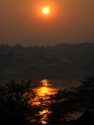 Sunset over the Mekong River looking at Thailand