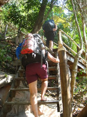 Sarah and Pat climbing the stairs to our Bungalow
