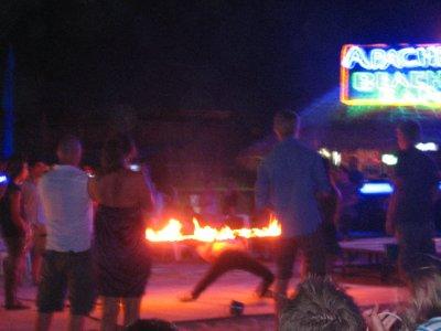 Limboing under fire on Ko Phi Phi Beach