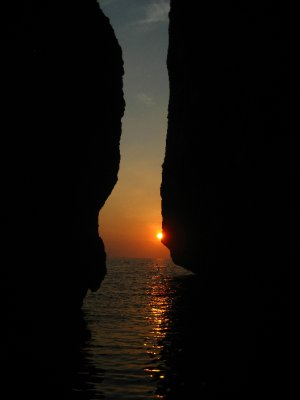 Man and Women's Rock Face at Sunset