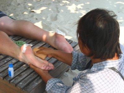 Tyler Getting a Foot Scrub on The Beach
