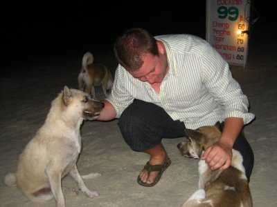 Tyler playing with the dogs