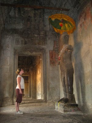 Clara at a statue in Angkor Wat