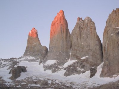 The tips of Las Torres start to glow red