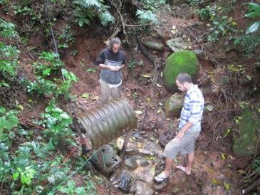 Checking out a problem with the hydro-electric system that powers the farm - fortunately I was there to fix it