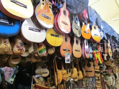 Shopping for a Charango in the markets of Cochabamba - only 1000 to choose from!