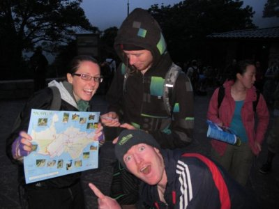 Waiting in the early morning cold and drizzle for the gates to Machu Picchu to open