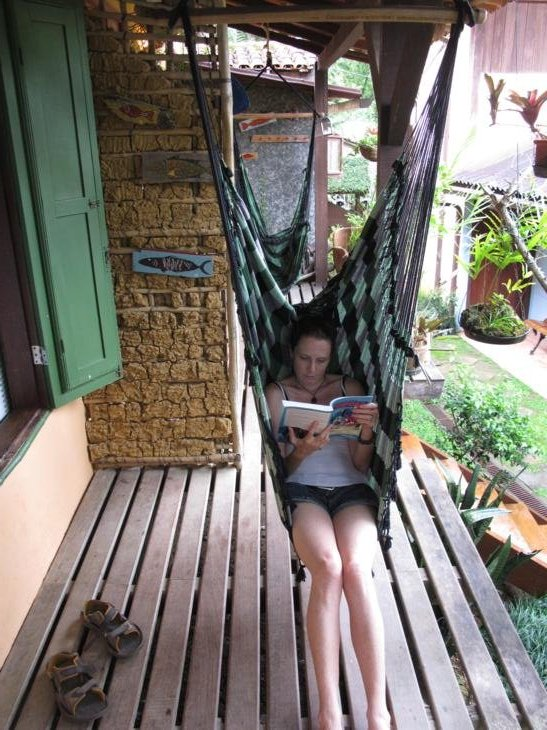 Making the most of rainy days- swinging in hammocks and reading.
