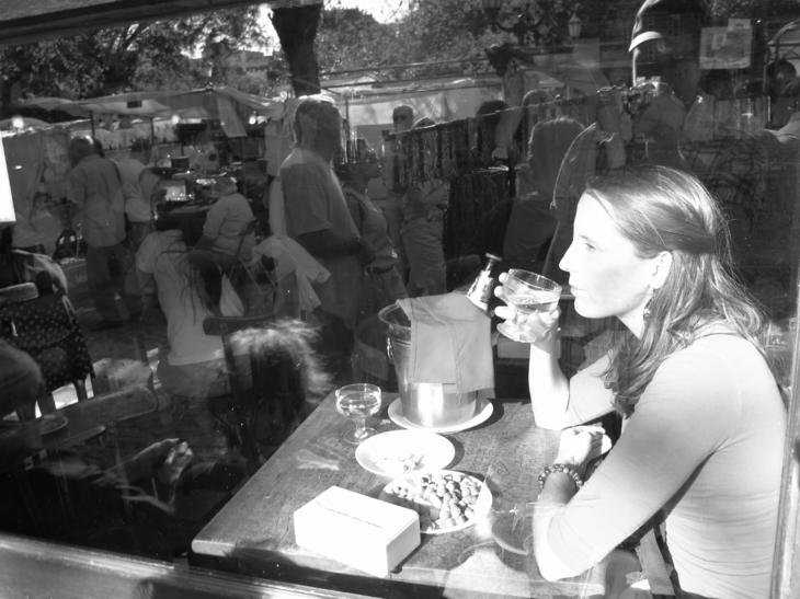 Chelle lost in a moment at Plaza Dorrego Bar (San Telmo plaza)