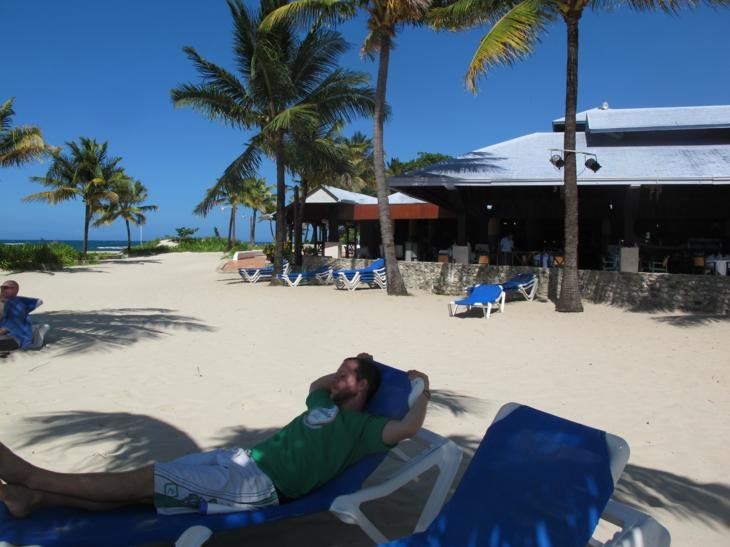 Enjoying the private beach of the resort