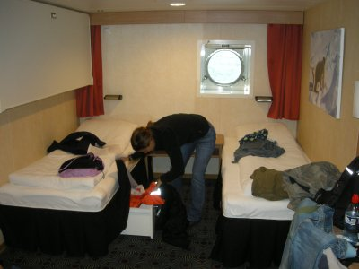 Sarah unpacking in our cabin- single beds were good when boat was rocking 45 degrees