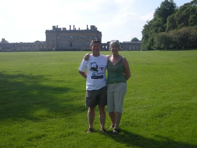 Neil (with his Galapagos tshirt on) and Helen at Heythrop Park with the main house in the background