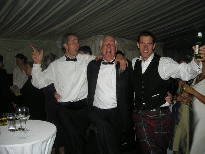 The groom in tartan, his father and brother