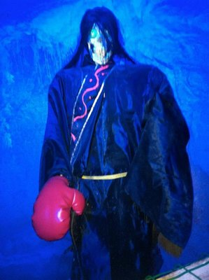 skeleton with boxing glove in the fake cave