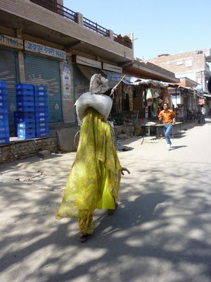 just one of the women balancing her load on her head