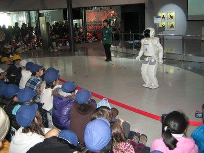 Adri and Po watching the robot dance