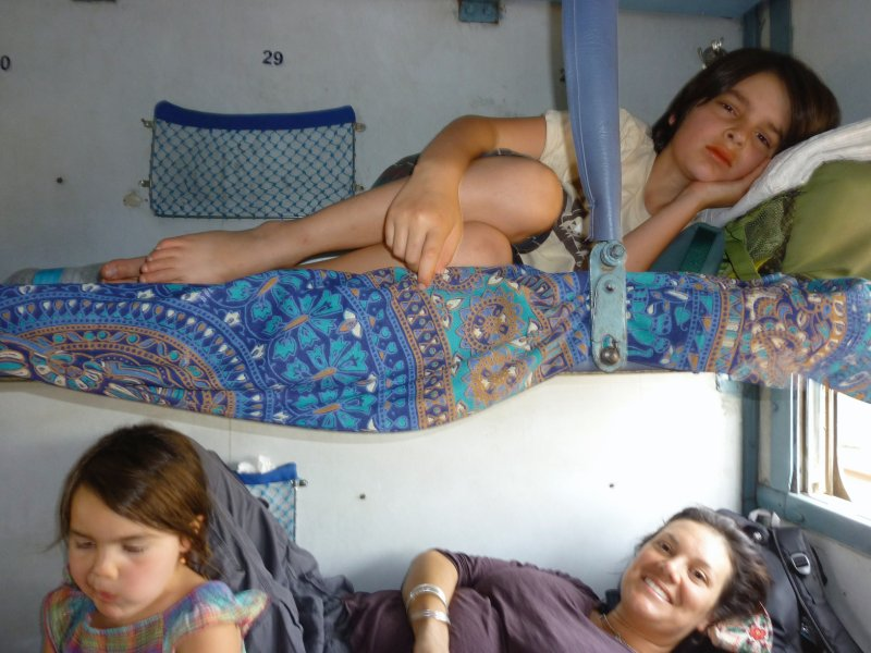 comfy on the train, poor Adri--look at him.