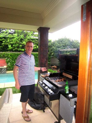 Duncan putting another prawn on the barbie