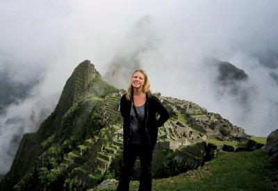 Machu Pichu finally revealing itself through the clouds