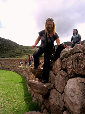 Climbing down the Incan steps into the Moray agricultural terraces