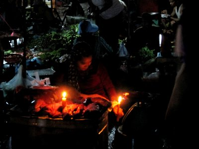 No electricity on the streets at night, so market under candle light