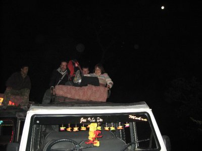 Holding on for dear life! Night safari on the roof rack of a jeep!