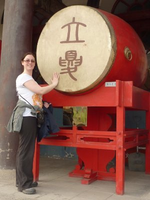 Rosie banging the Drum at the Drum Tower