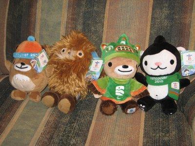 Furry critters--Sumi, Quatchi, Miga, Mukmuk take in the games.