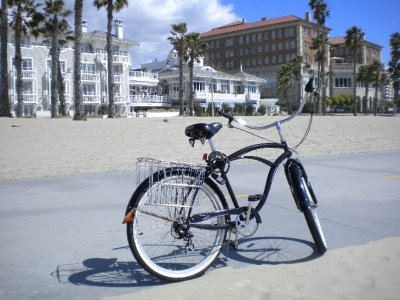 My beach cruiser on the boardwalk facing some way too expensive hotels
