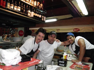 Service with a smile, our waiters/cook at Mercado del Puerto