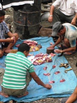 Villagers prepare dinner