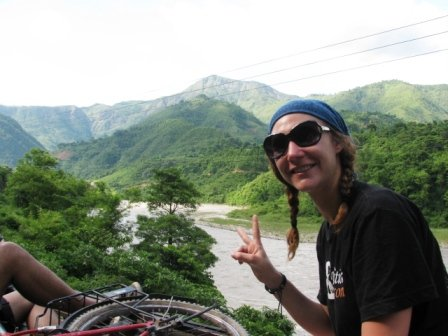 Riding on the top of a public bus through the jungles of Nepal
