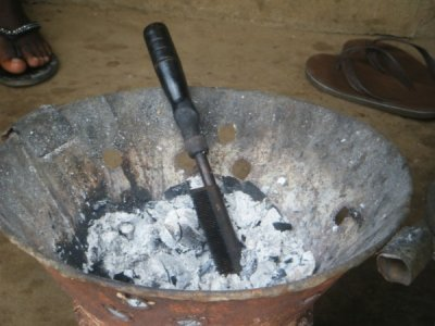 african hair straightener...wooden handle and metal comb heated in coals Photo by BCholewa