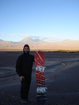 Sandboard, vulcano background, and Henrik