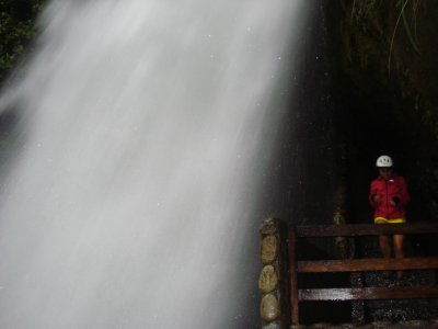 Laura under a waterfall