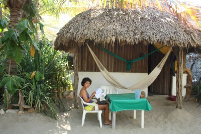 Laura chilling outside our beach bungalow