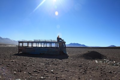 Abandoned bus in the middle of the desert