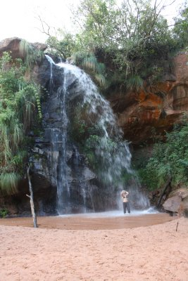 Laura taking a shower in a waterfall near Samaipata