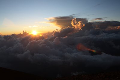 Sun slowely going down behind the clouds..view from the volcano