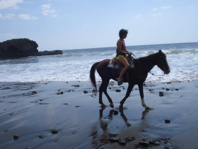 Laura enjoying her birthday ride on the beach, we must have looked like real gringos