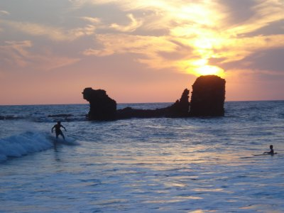 Sunset surfing in Playa El Tunco