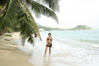 Laura posing up on a deserted beach